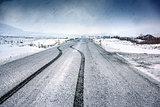 Empty snowy highway