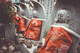 Jizo statues in Arashiyama temple, Kyoto, Japan