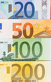 Background from different euro banknotes close up.
