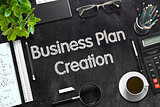 Business Plan Creation on Black Chalkboard. 3D Rendering.