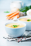 Vegetable cream soup in bowl over grey concrete background