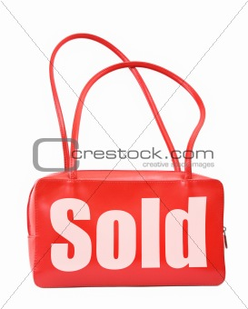 handbag with sold sign
