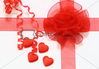 four hearts and ribbons on white