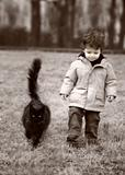 toddler walking his cat