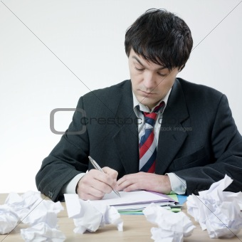 Businessman  with difficulty to write