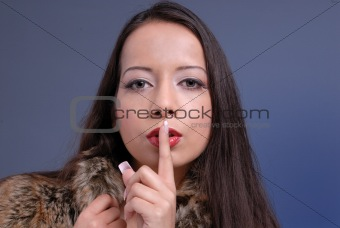 attractive woman gestures silence