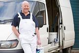 Decorator Standing Next To White Van