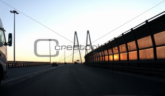 Automobile bridge at sunset