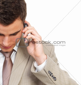Handsome young business man talking on phone.