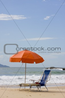 Chairs and parasol on beach