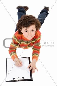 Boy write in clipboard