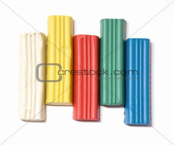 Five plasticine blocks on white background