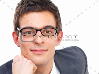 Portrait of happy young business man wearing glasses