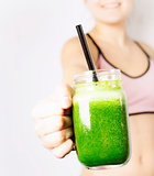 Teenage girl with green smoothie