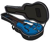 The retro blue electric guitar in a case