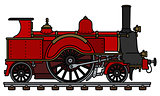 The vintage red steam locomotive