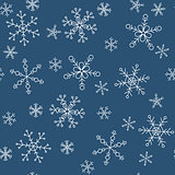 Snowflakes of different styles on a background of blue, pattern