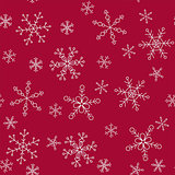 Snowflakes of different styles on a background of red, pattern