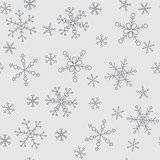 Snowflakes of different styles on a background of gray, pattern