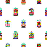 Colorful tiki mask seamless pattern vector.