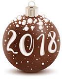 Brown chocolate 2018 christmas ball with sugar coating. Sweet holiday decoration