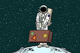 Astronaut traveler with travel suitcase