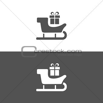 Sled icon with gift on white and black background