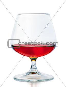A glass of cognac on a white background