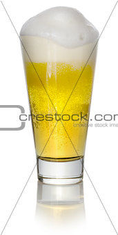 A glass of light beer on a white background