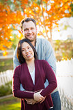 Outdoor Fall Portrait of Chinese and Caucasian Young Adult Coupl
