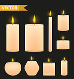 Realistic beige candles set. 3d burning candle collection. Isolated on a black background. Vector illustration.