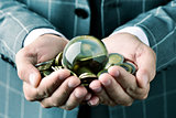 businessman with a crystal ball and euro coins