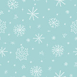 Christmas seamless pattern with snowflake on blue background. Hand drawn design