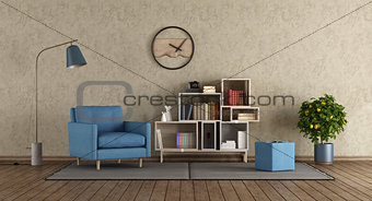 Blue armchair in modern lounge
