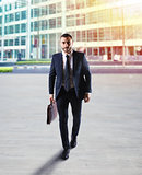 Determinated businessman walking in the city