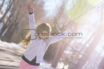 Little cheerful girl paying outdoors