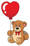 Teddy bear with heart shaped balloon