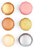 French colorful macarons dessert cakes top view