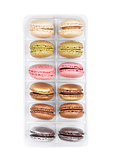 French colorful macarons dessert cakes in tray