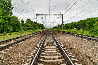 Train tracks go over the horizon line