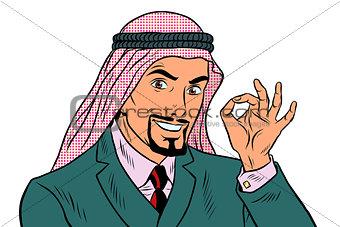 OK gesture Eastern businessman isolated on white background