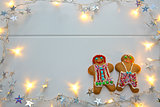 Male and Female Christmas Cookies with garland.