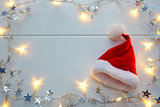 Red Santa Claus hat and garland isolated .