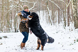 Dog hugging his mom on a winter day with snow