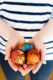 Close up of girl holding colorful painted Easter eggs