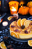 Delicious pumpkin and orange cheesecake decorated with caramel s