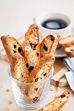 Italian cranberry almond biscotti  and cup of coffee on backgrou
