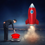 Businessman launches rocket pushing a red button. 3D Rendering