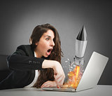Businesswoman launches rocket from a laptop. concept of company startup