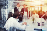 Blurred background of business people in office with futuristic effect